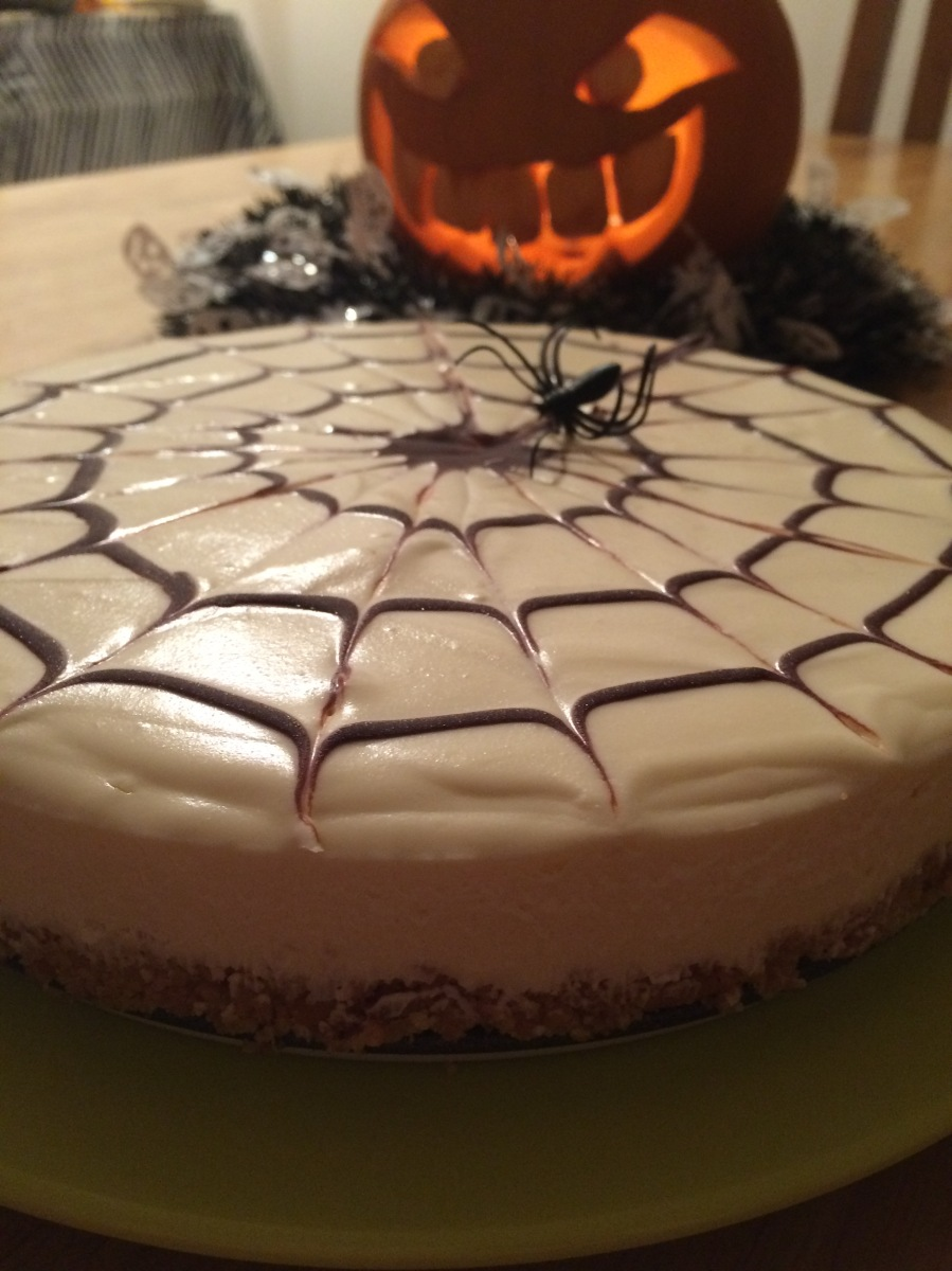 Photo of a spider-web cheesecake.