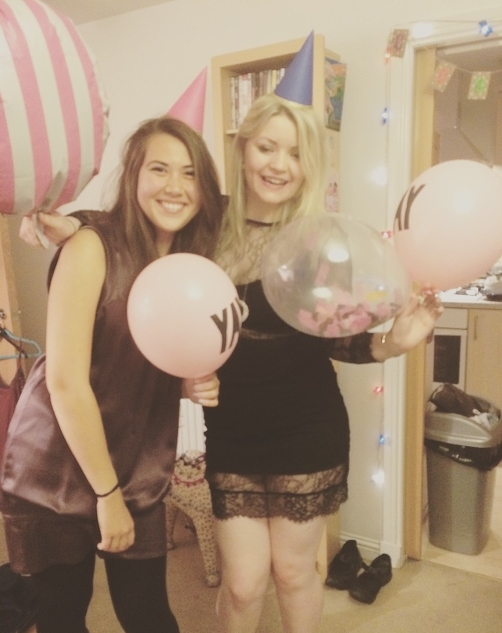 Eve and Yanni with balloons.